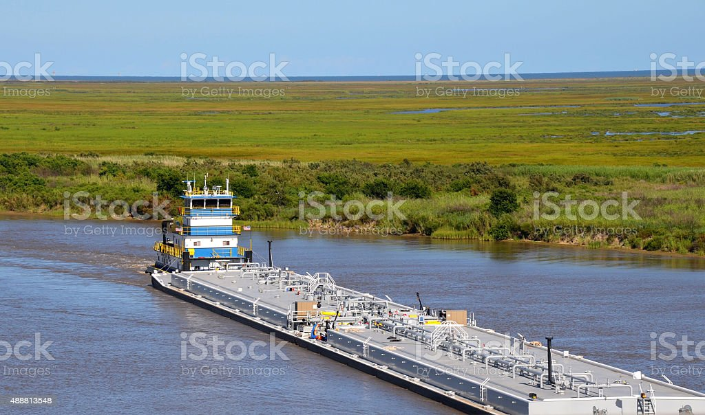 Oil barge pushed by tugboat stock photo