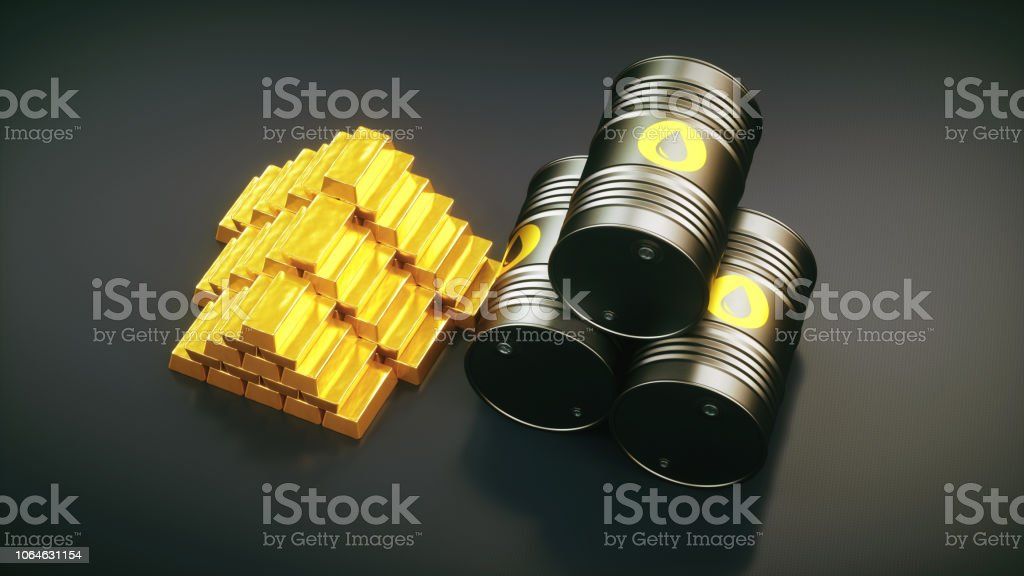 Oil barrels stacked with a pile of gold ingots top view stock photo