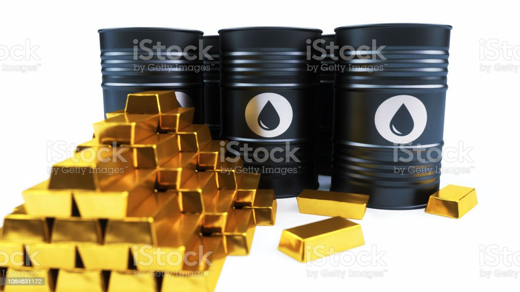 Oil barrels with a pile of gold ingots isolated on white stock photo