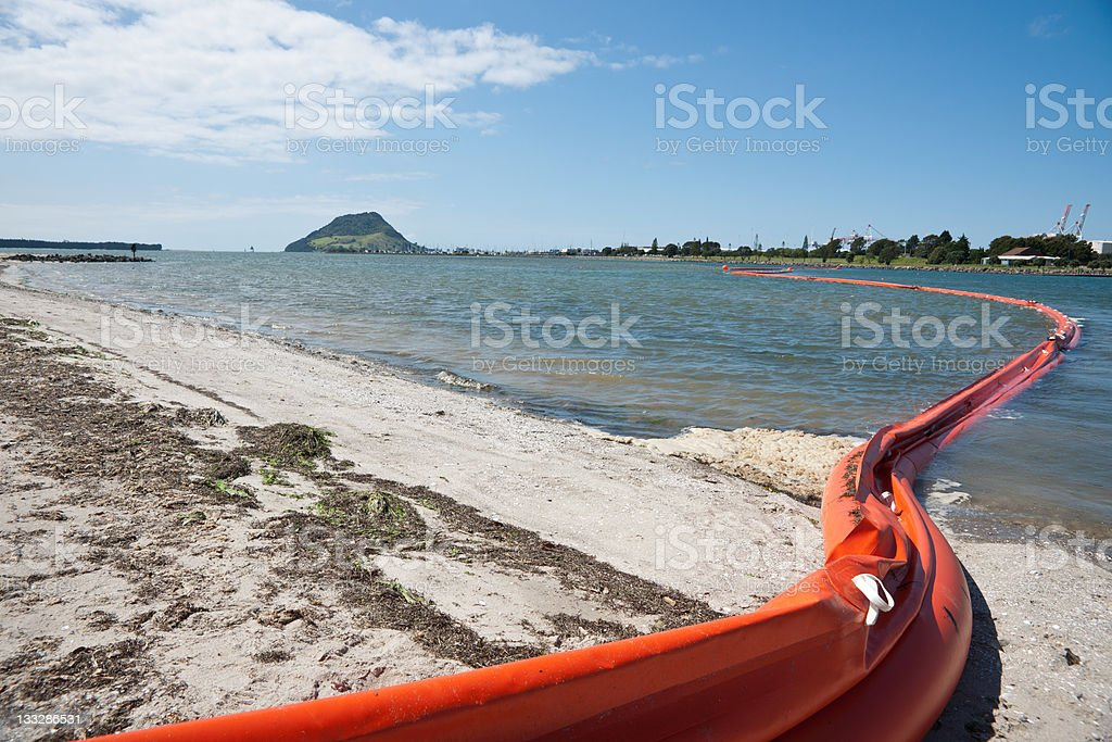 Oil boom in Tauranga Harbour. stock photo