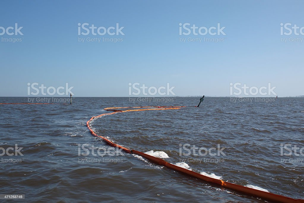 Oil Boom stretching across the channel stock photo