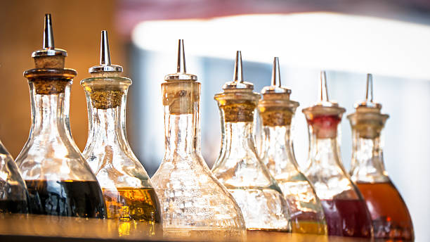 oil bottles bottles with oil at a restaurant in italy (near rome) vinegar stock pictures, royalty-free photos & images