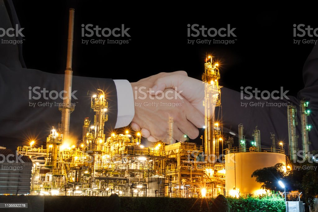 Business people shake hand success a contract with the crisis, oil...