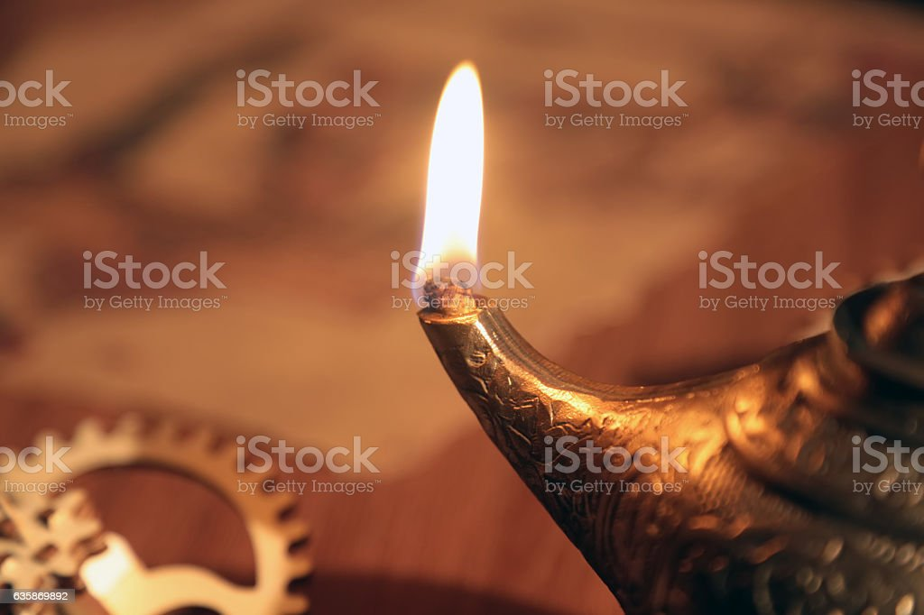 Oil Candle on an Old Islamic Scientist's Desk stock photo