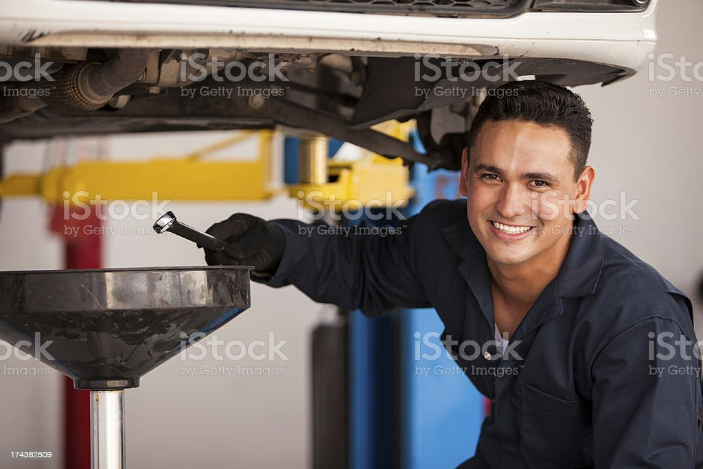 Oil change at an auto shop stock photo
