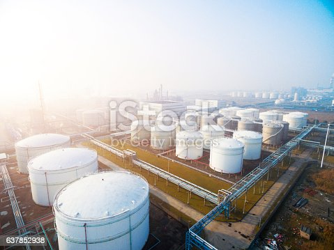 top view of white oil tank in modern refinery plant in blue sky