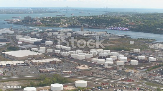 istock AERIAL: Oil depot storage with underground fuel tankage near port for bulk ships 1078044690
