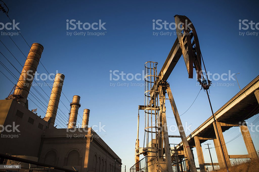 Oil Derrick and Factory royalty-free stock photo
