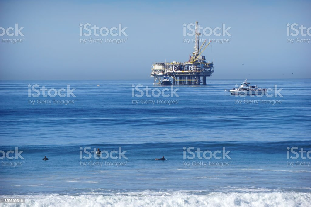 oil derrick in ocean stock photo