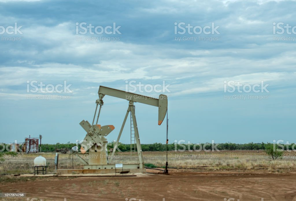 oil derrick on side of road in west texas stock photo
