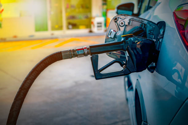 Oil dispenser gas station  Car refueling on a petrol station Oil dispenser gas station  Car refueling on a petrol station biofuel stock pictures, royalty-free photos & images