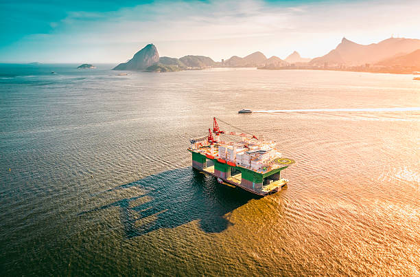 Oil drilling rig against panorama of Rio De Janeiro, Brazil stock photo