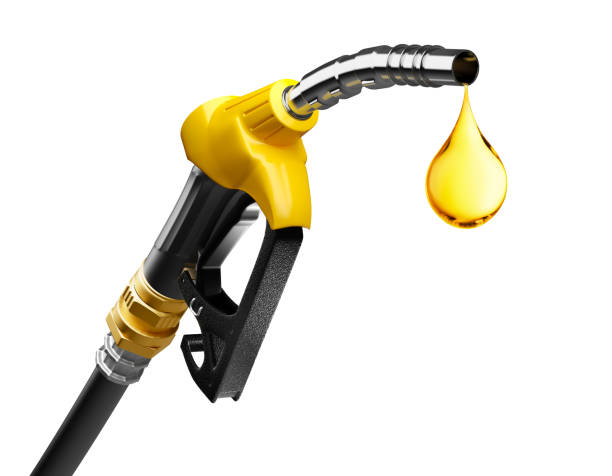 Oil dripping from a gasoline pump Oil dripping from a gasoline pump isolated on white background gasoline stock pictures, royalty-free photos & images