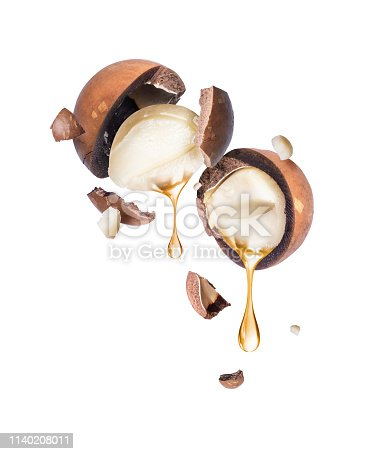istock Oil dripping from macadamia nut on a white background 1140208011