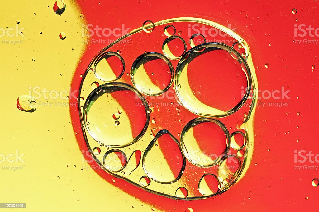 Oil drops on a water surface royalty-free stock photo
