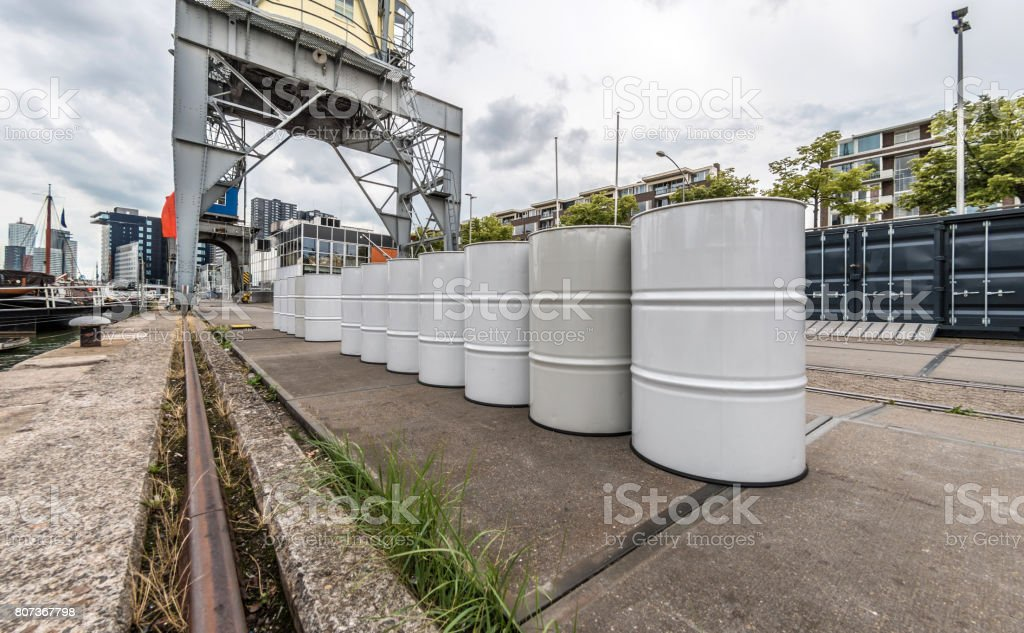 Oil drums on dockside in Rotterdam stock photo