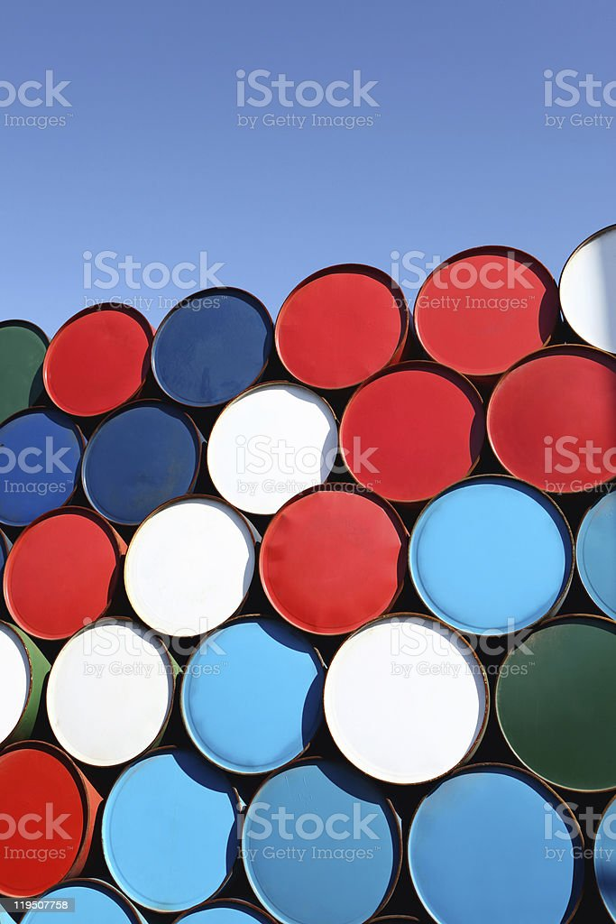 Oil drums stacked on top of each other in colors stock photo