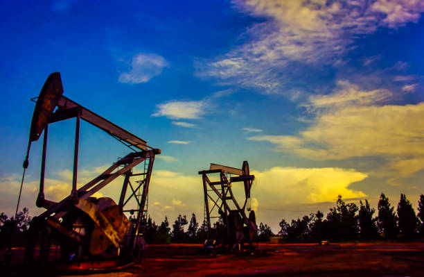 oil extraction in fields with abundant production - venezuela stock photos and pictures
