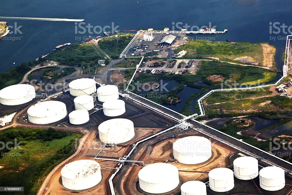 Oil farm with river stock photo