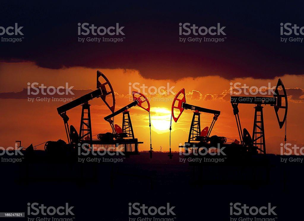 Oil field at sunset. stock photo