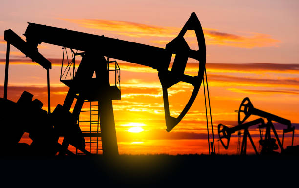 oil field. - crude stock pictures, royalty-free photos & images