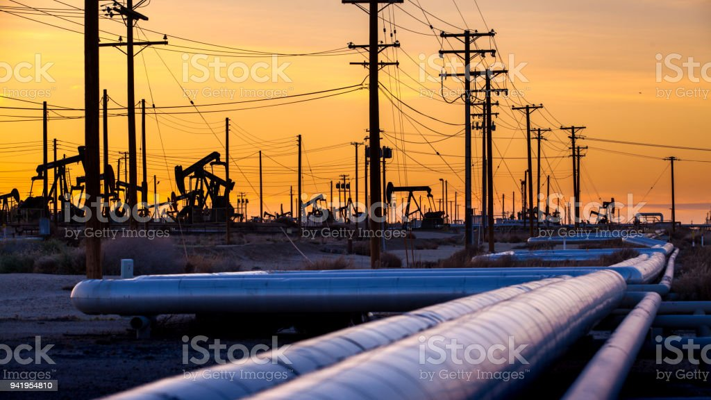 Oil field pipeline at sunset, Midway-Sunset Oil Field stock photo
