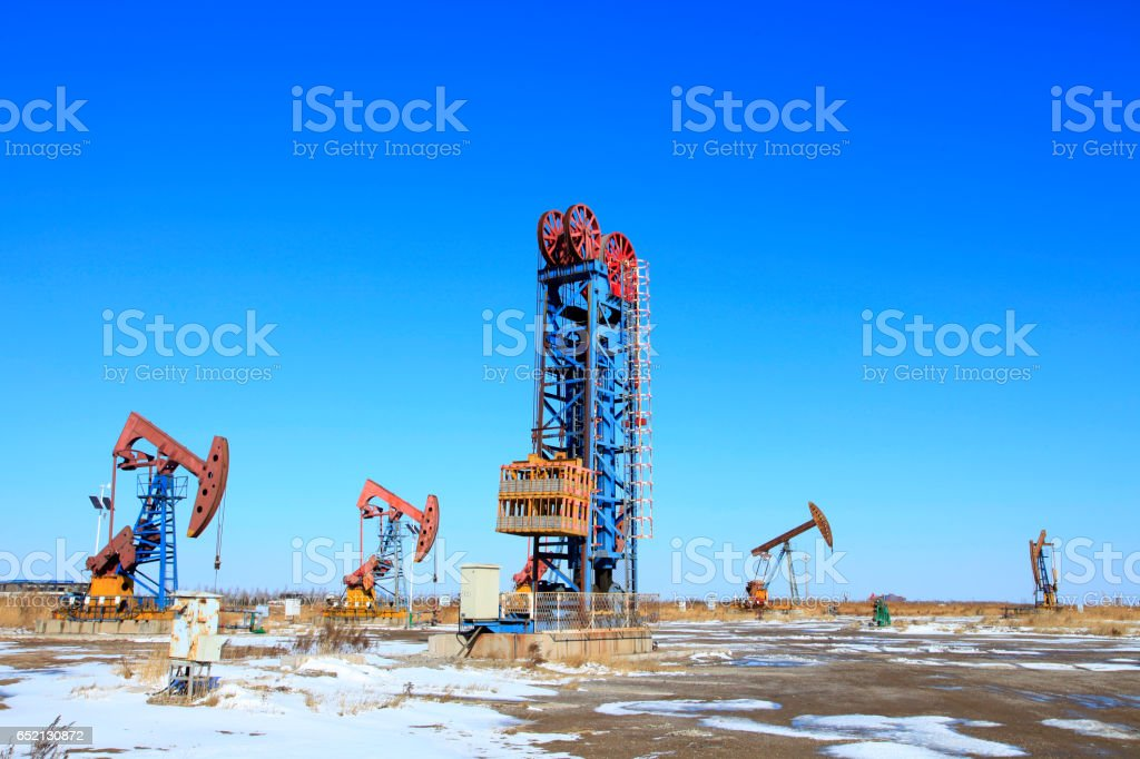 Oil field scene,Tower type pumping unit under the blue sky stock photo