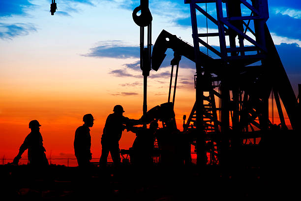 oil field, the oil workers are working oil field, the oil workers are working oil industry stock pictures, royalty-free photos & images
