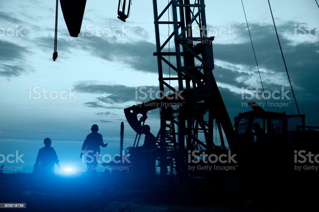 oil field, the oil workers are working stock photo