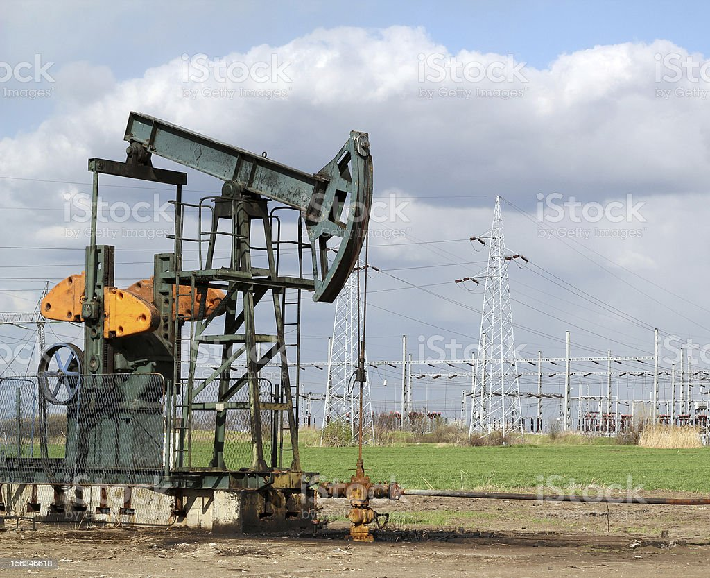 oil field with pumpjack royalty-free stock photo