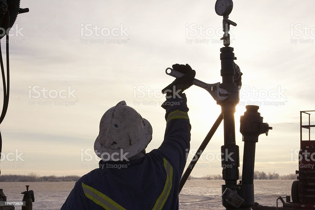 Oil Field Worker at Sunrise stock photo