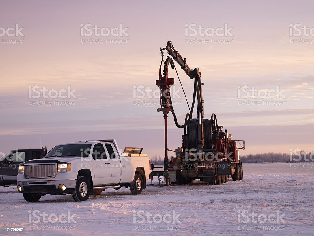 Oil Field Workers at Sunrise royalty-free stock photo