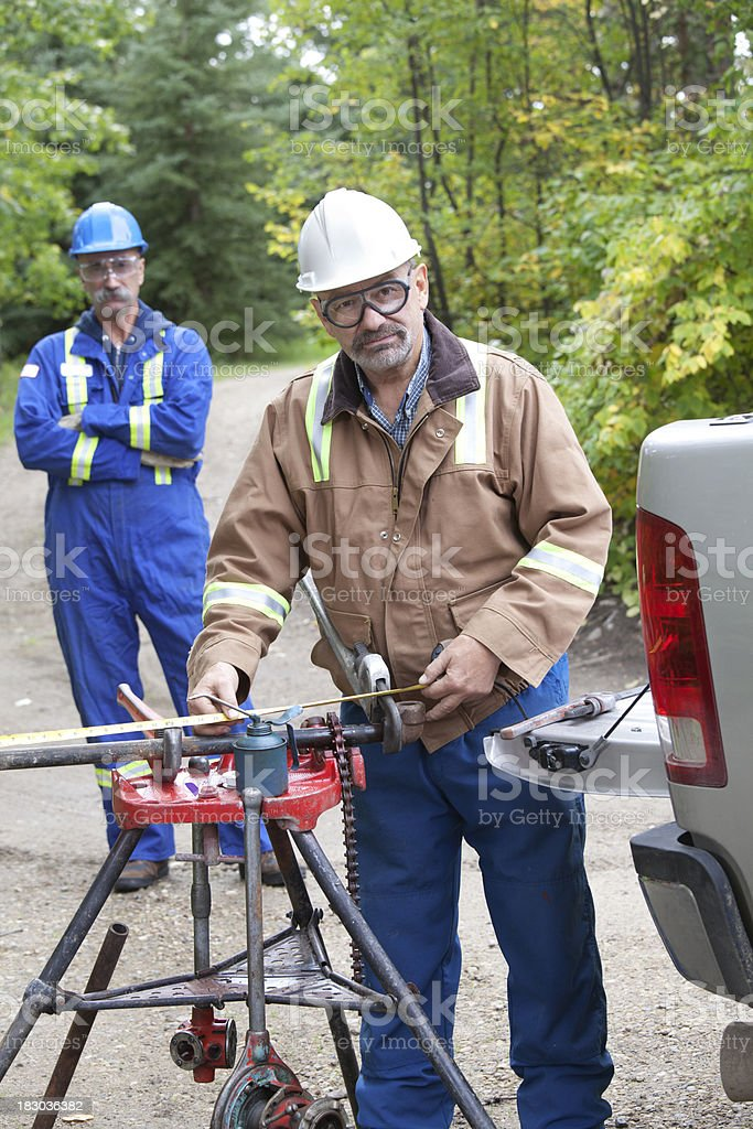 Oil Field Workers stock photo