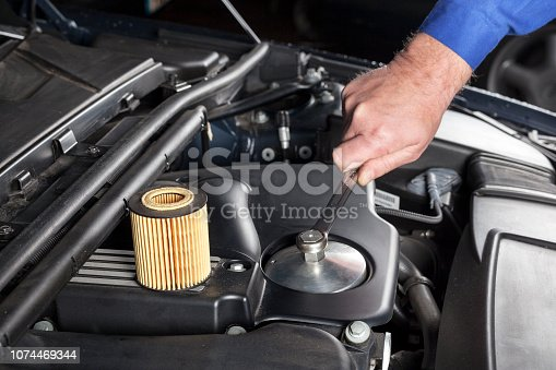 Mechanic is preparing an oilfilter change at a modern car engine