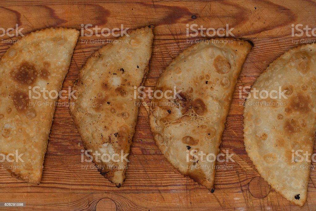 Oil fried closed pies. stock photo