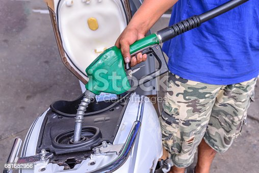 istock Oil fueling to motorcycles. 681652956