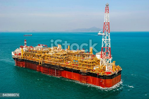 View of FPSO oil rig, floating production, storage and offloading vessel used to explore the crude oil & gas under the seabed.