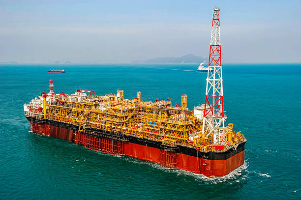 Oil & Gas offshore FPSO Oil Rig View of FPSO oil rig, floating production, storage and offloading vessel used to explore the crude oil & gas under the seabed. floating on water stock pictures, royalty-free photos & images