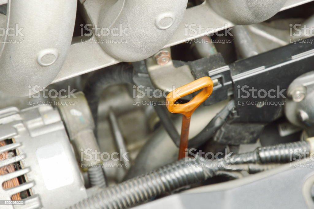 oil gauge stick for checking lubricant level stock photo