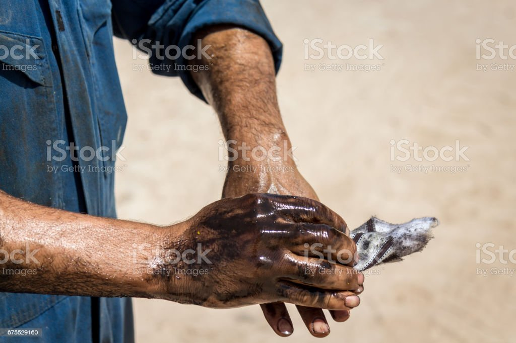 Oil greasy hands stock photo