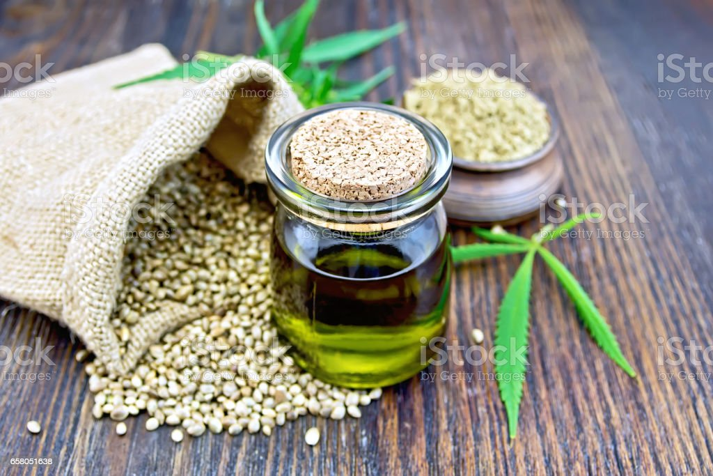 Oil hemp with flour on board stock photo