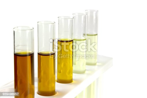 istock oil in glass tube isolate on white background, hydraulic oil testing in industry laboratory 939498552