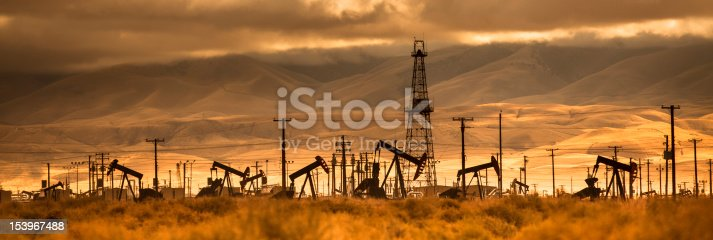 A nodding donkey rig pumps crude up from the ground on an oil field