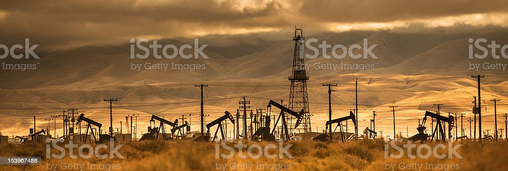 Oil industry well pumps stock photo