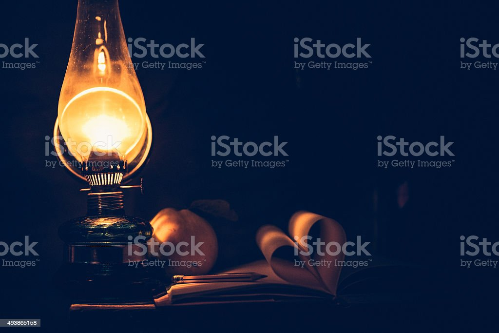 Oil lamp and book stock photo