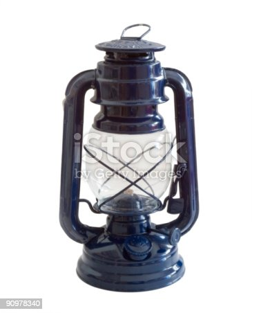 An old blue oil lamp isolated on white
