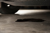 istock Oil leak or drop from engine of car on concrete floor , check and maintenance auto service 1163250729