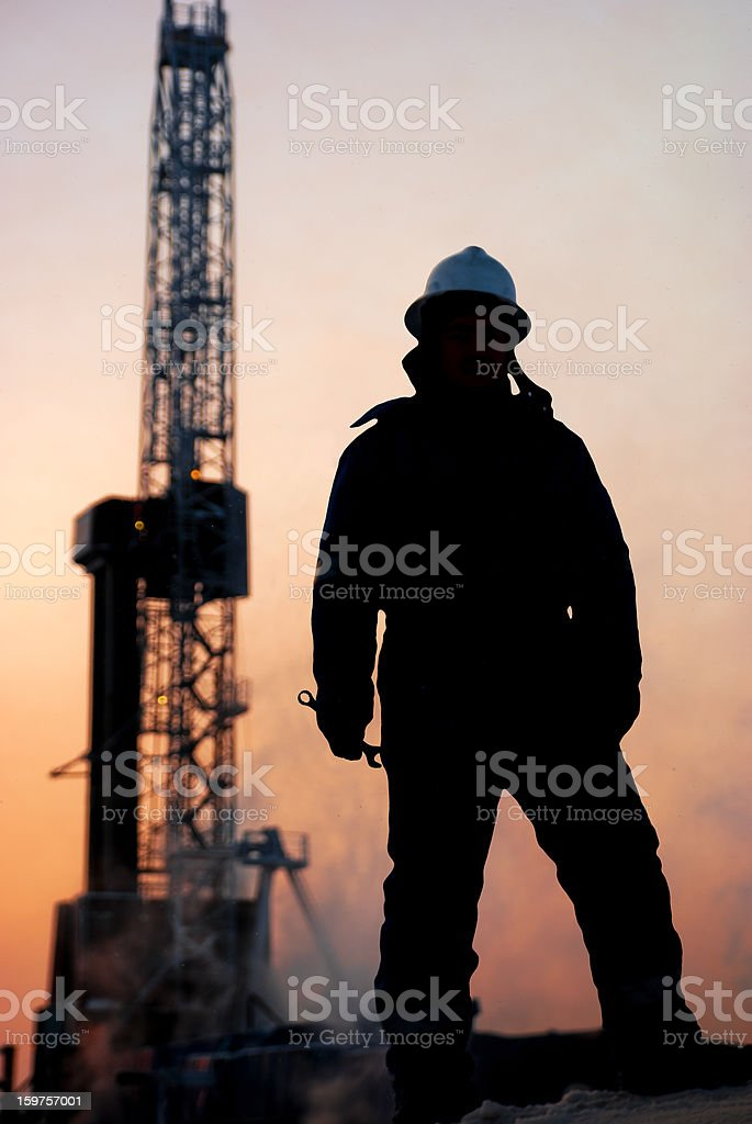 Oil man at dusk stock photo