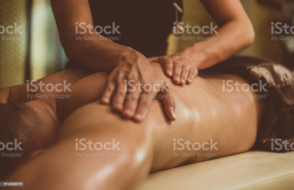Oil Massage of Male Torso stock photo