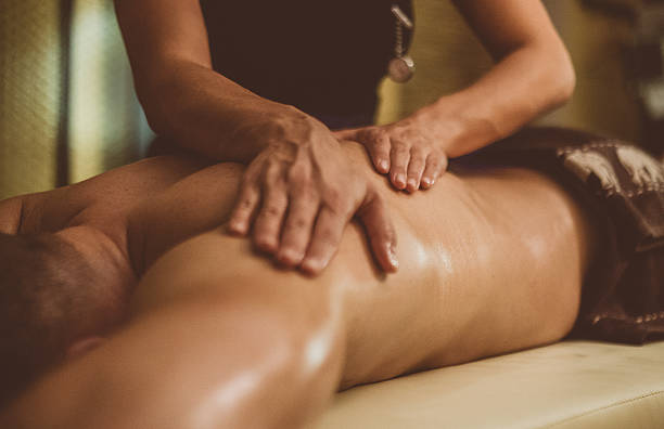 oil massage of male torso - massage therapist stock pictures, royalty-free photos & images